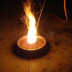 The resulting sparks, smell and bright light make for a dramatic demonstration of a direct reduction of iron oxide with carbon.